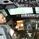 "Mark R. in the UK takes his ""There I Wuz!"" Bible with him to his B-737 sim session!"