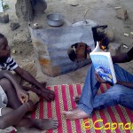 My dear Blog Buddy Kelvin reads to his nephews in Tanzania!