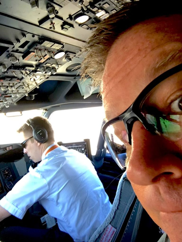 Squeezed into the 2nd jumpseat aboard an AK Airlines 737. My, but those FOs are looking younger each year!